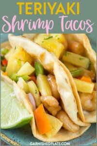 We utilize a simple bag of frozen shrimp, a make ahead homemade teriyaki sauce and a simple but amazingly delicious pineapple salsa!  What more could you ask for other than a homemade meal sure to impress that can also be on the table in under half an hour. #garnishedplate #teriyaki #shrimp #tacos #pineapplesalsa width=