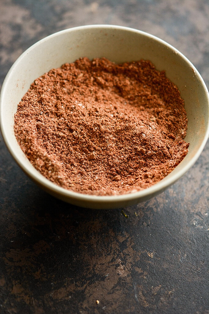 Homemade taco seasoning in a gray bowl.