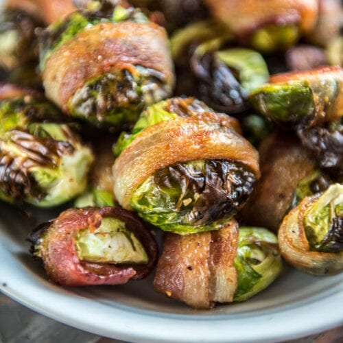 Air Fryer Bacon Wrapped Brussels sprouts in a gray bowl