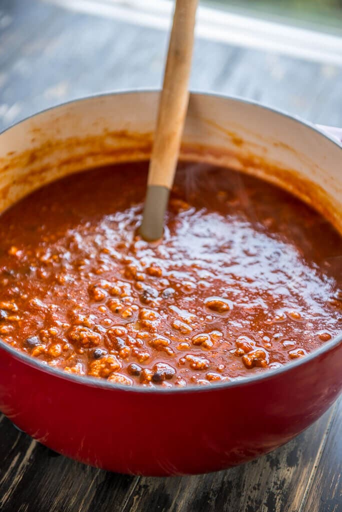The Best IPA Beer Chili in red dutch oven with a ladle