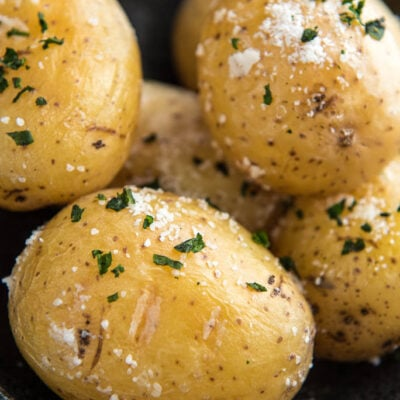 baked potatoes with salt and parsley in a large bowl