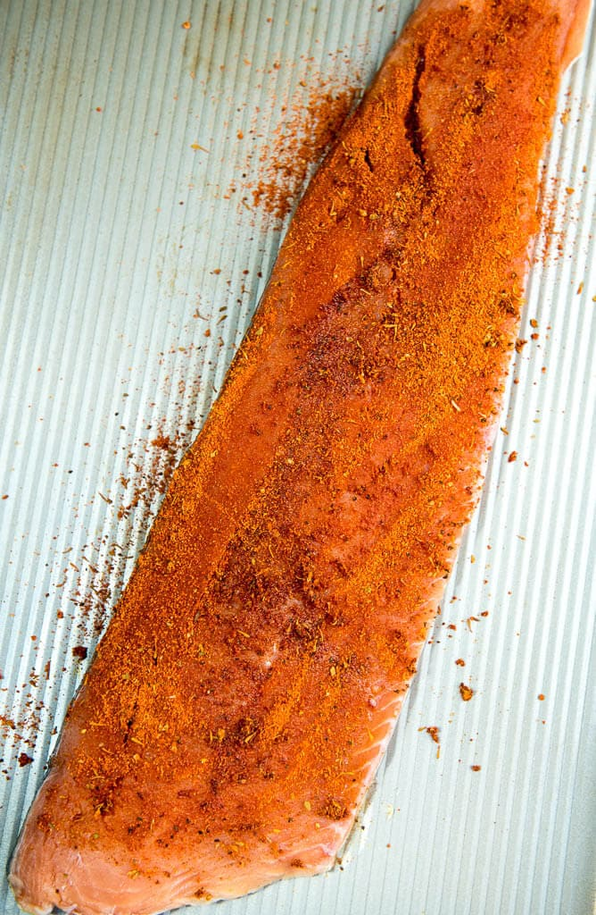salmon with blackening seasoning ready to grill