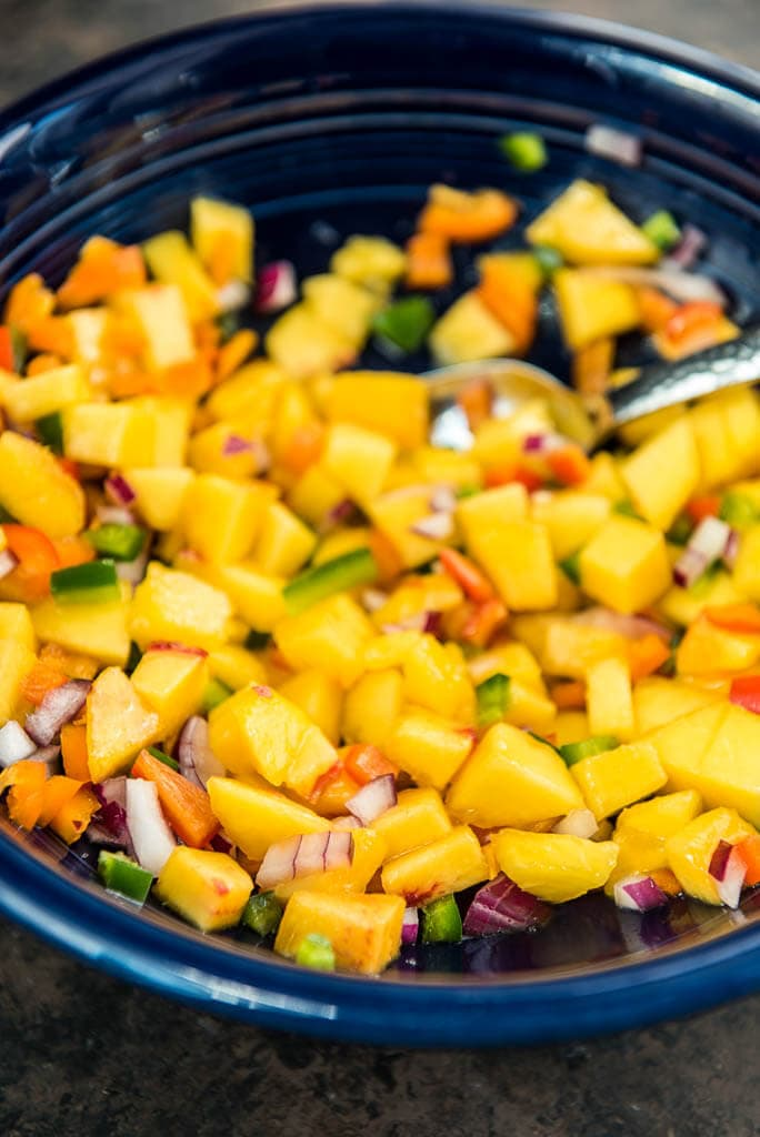 peach salsa in blue bowl to go with blackened smoked salmon