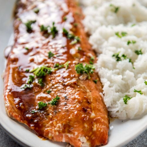 Korean BBQ Grilled Salmon on white serving platter with steamed rice