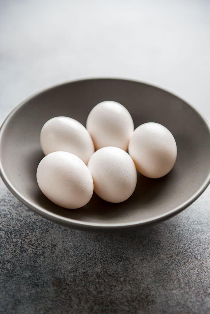 uncracked eggs in gray bowl for Instant Pot Sous Vide Egg Bites