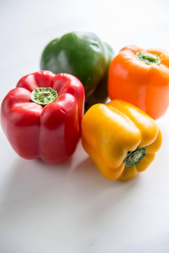 red, yellow, orange and green peppers ready to chop and make stuffed pepper soup