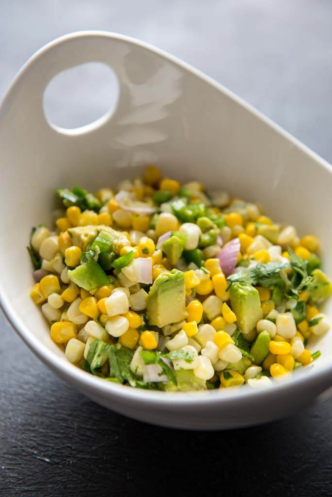 Avocado Corn Salsa in a white bowl