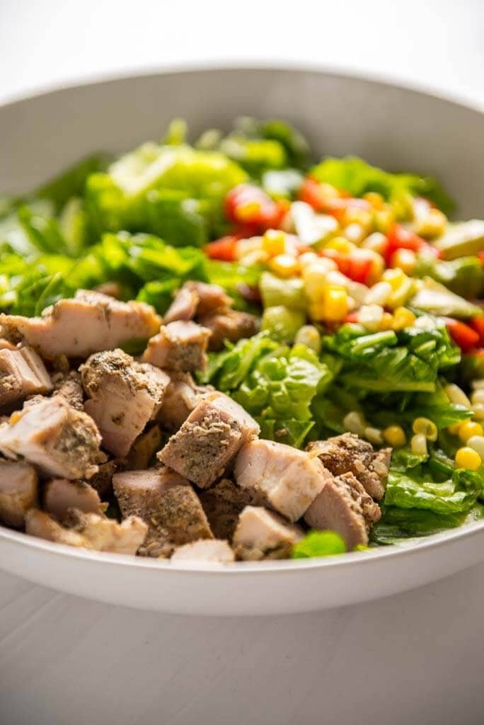 chopped grilled chicken thighs on a salad