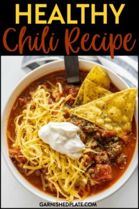 If you've never tried cooking with ground bison, this healthy chili recipe will have you using it on a regular basis! Ground bison is low in saturated fat and high in nutrientsand along with extra veggies like butternut squash, carrots and pumpkin make this a rich and delicious healthy chili for lunch or dinner! #garnishedplate #chili #bison #groundbison #healthy #healthyrecipe