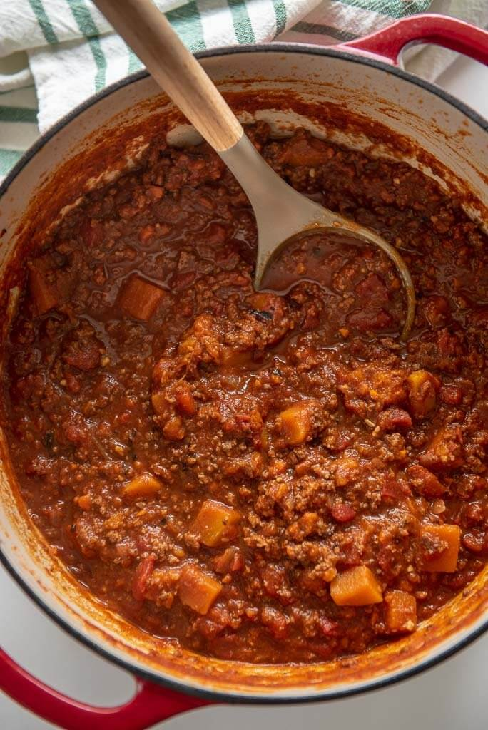 healthy chili recipe in a red cast iron dutch oven