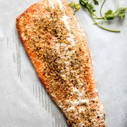 salmon filet baked in the oven with herbs