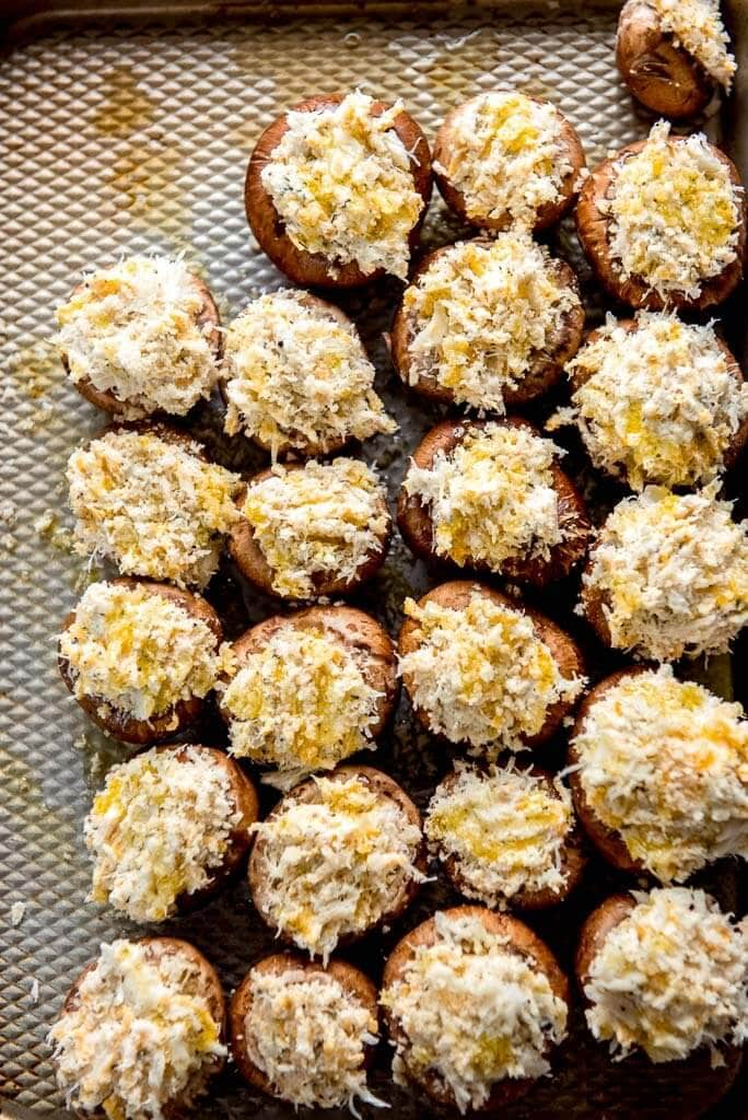 ready to cook stuffed mushrooms on a baking sheet