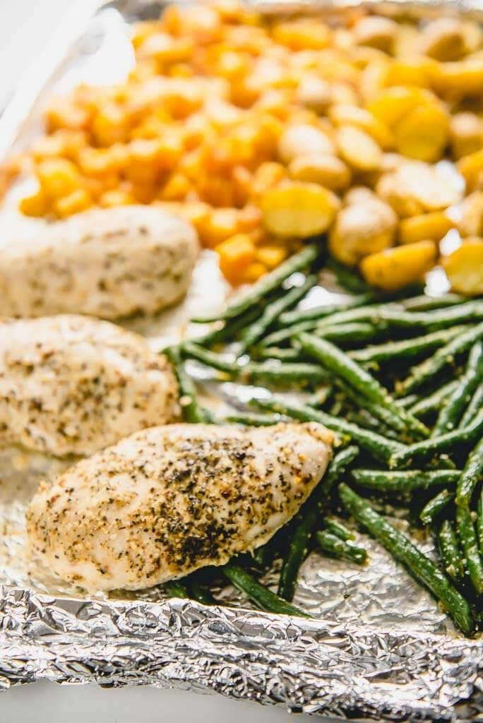 chicken, green beans, potatoes and butternut squash on a sheet pan