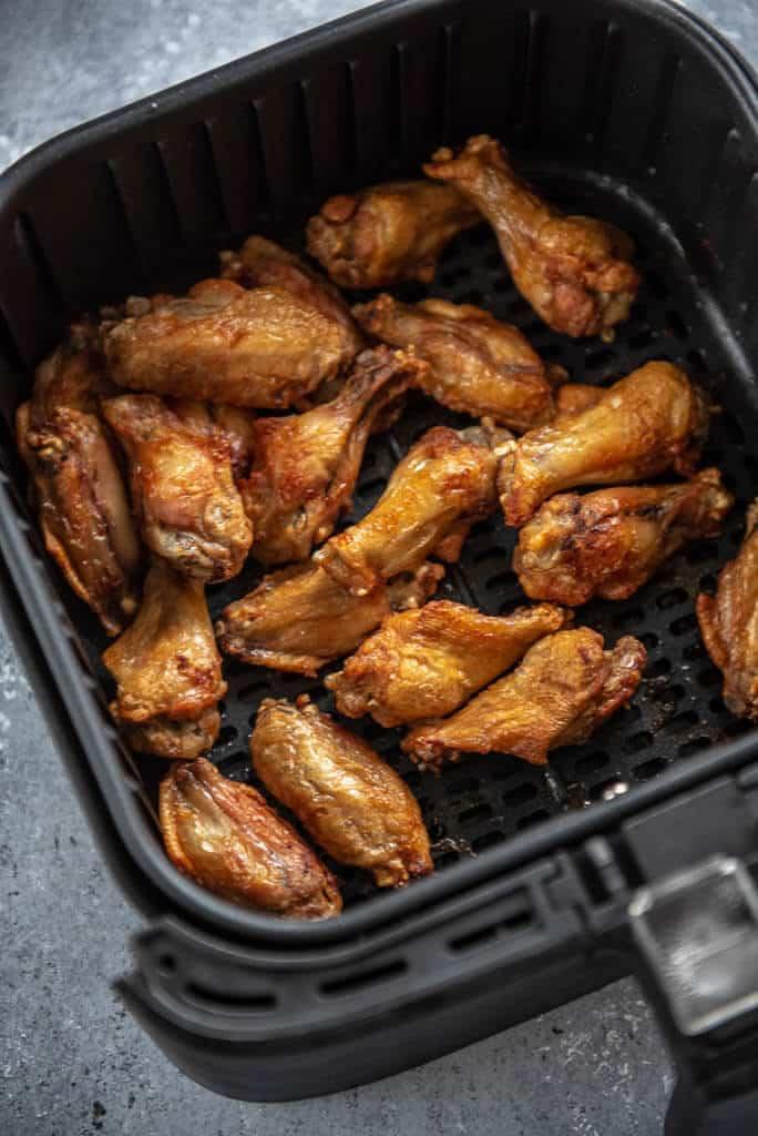 cooked chicken wings in air fryer basket
