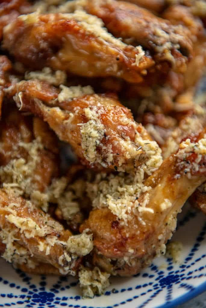 up close of air fryer chicken wings with garlic parmesan sauce