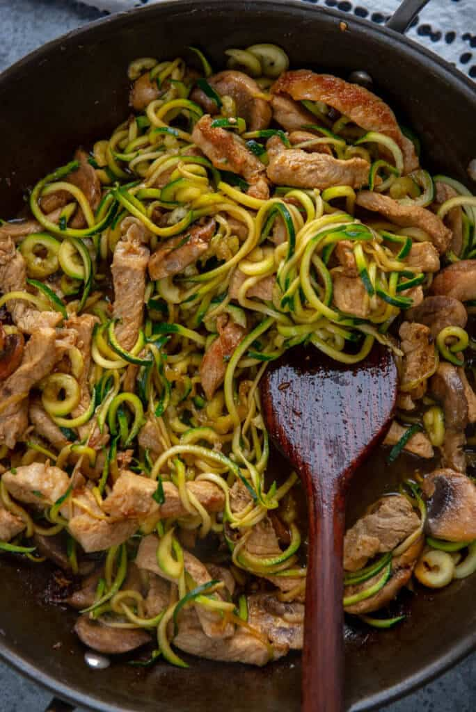 pork lo mein with zucchini noodles in pan