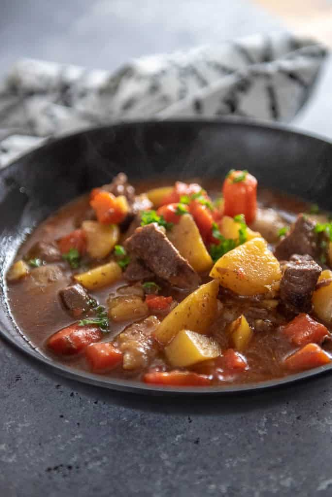 beef stew with carrots and potatoes in a bowl