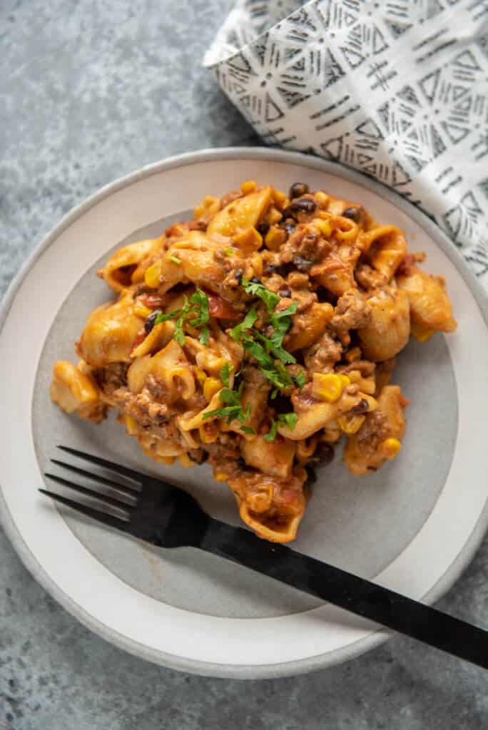 instant pot taco pasta on gray and white plate