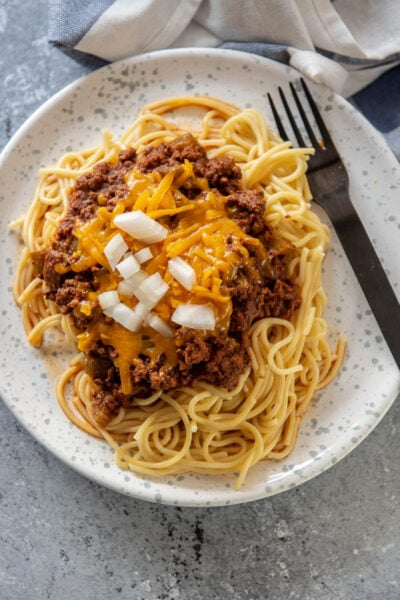 spaghetti noodles topped with Cincinnati chili on plate