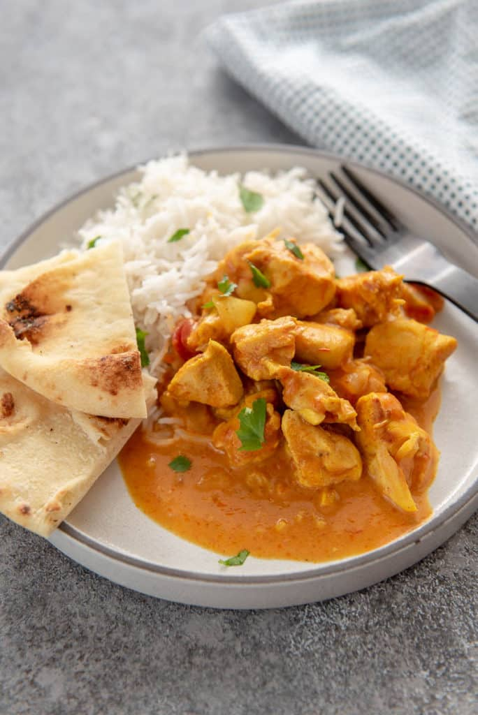 butter chicken from the instant pot on a white plate