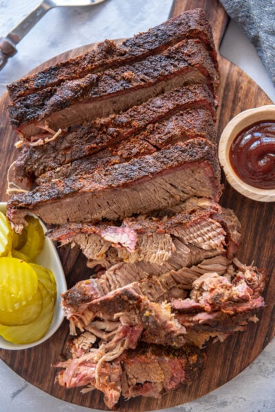 sliced brisket on round cutting board
