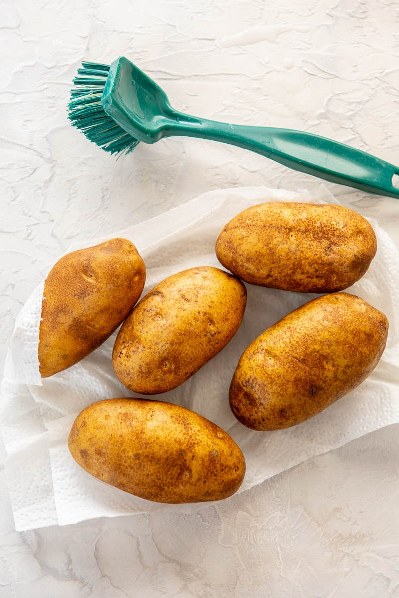 5 russet potatoes scrubbed on a paper towel for making fries