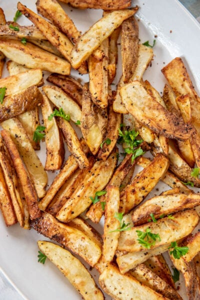 homemade French fries from the air fryer on a white platter