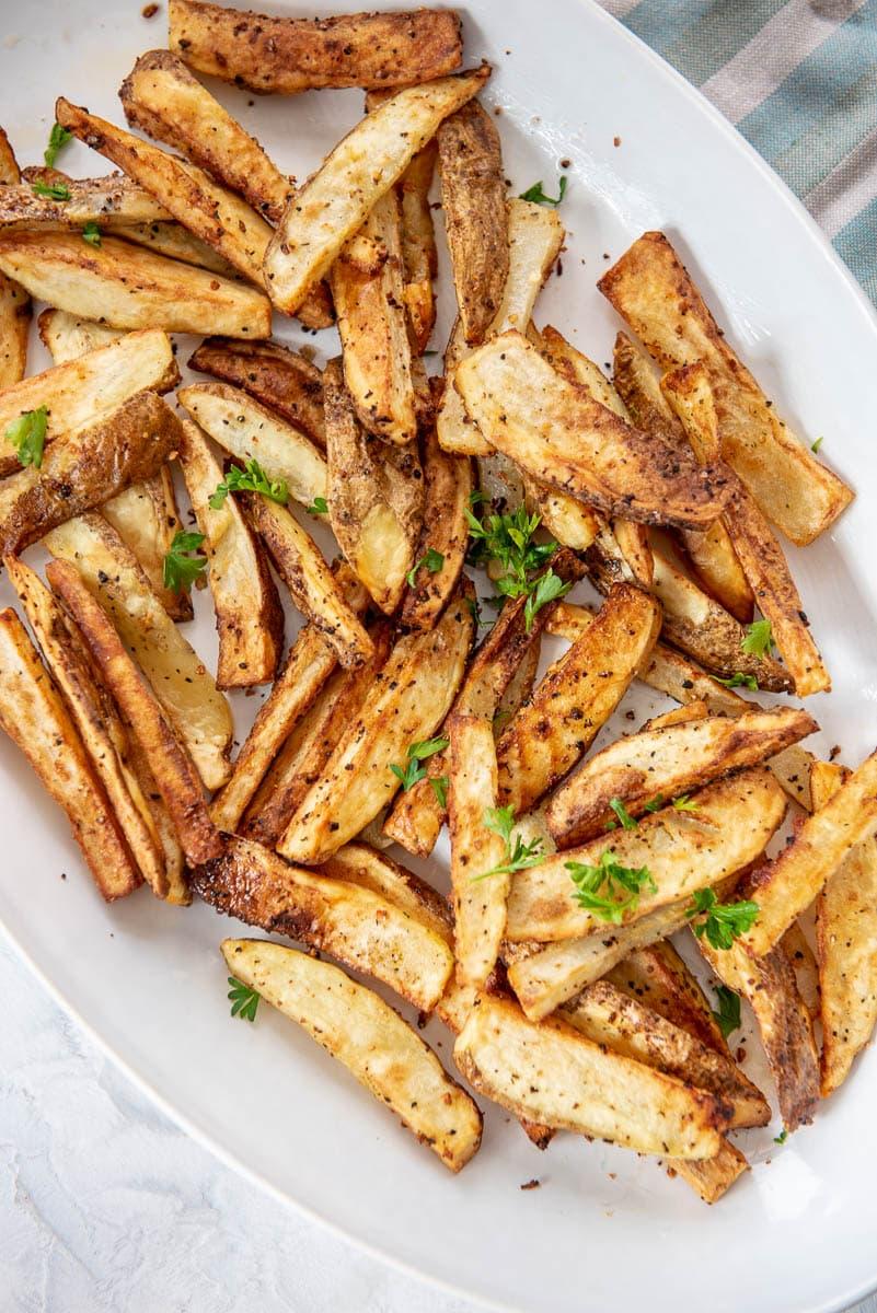 French fries on white platter