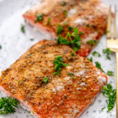 2 pieces of grilled salmon on white and blue plate