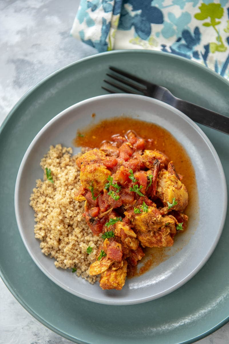 moroccan chicken with quinoa on a gray plate