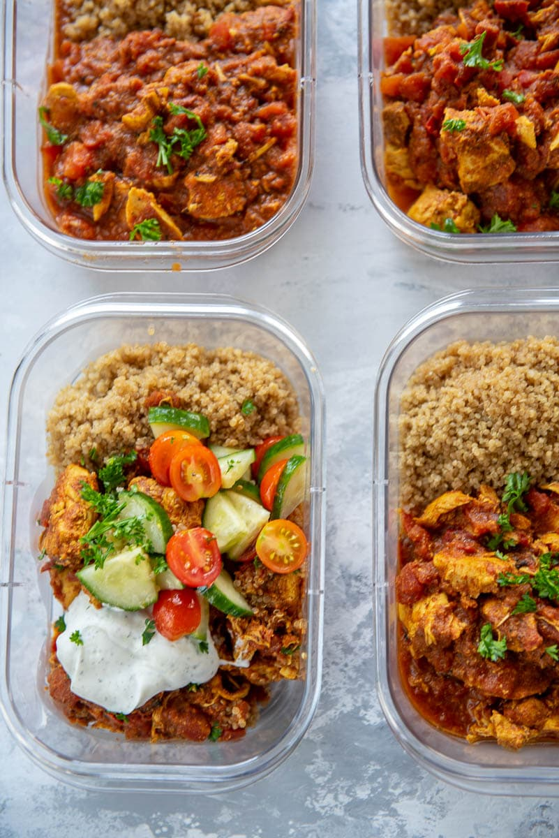 meal prep bowls filled with quinoa and moroccan chicken