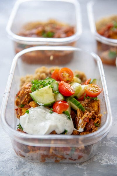 rectangle plastic food container with moroccan chicken and cucumbers