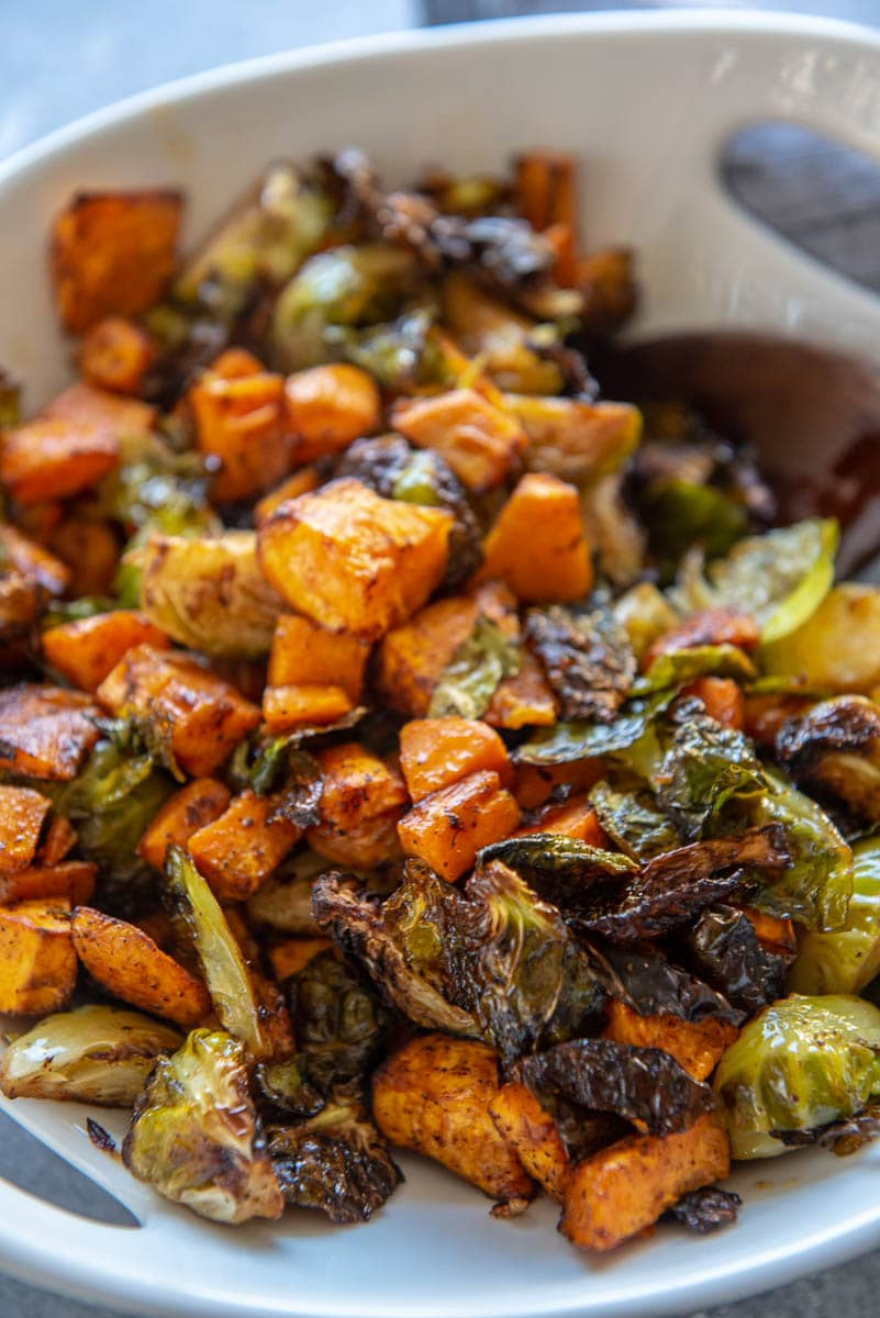 air fryer sweet potatoes and Brussels sprouts in bowl