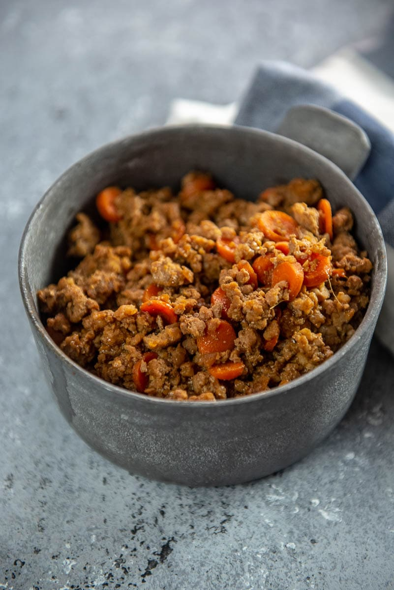 meat filling with carrots in a metal bowl