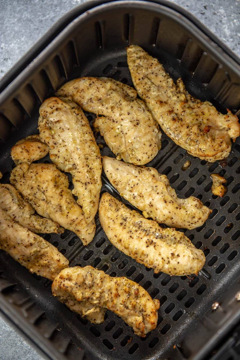 cooked chicken tenderloins in air fryer basket