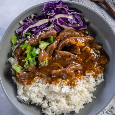 gray bowl with instant pot pepper steak rice and cabbage