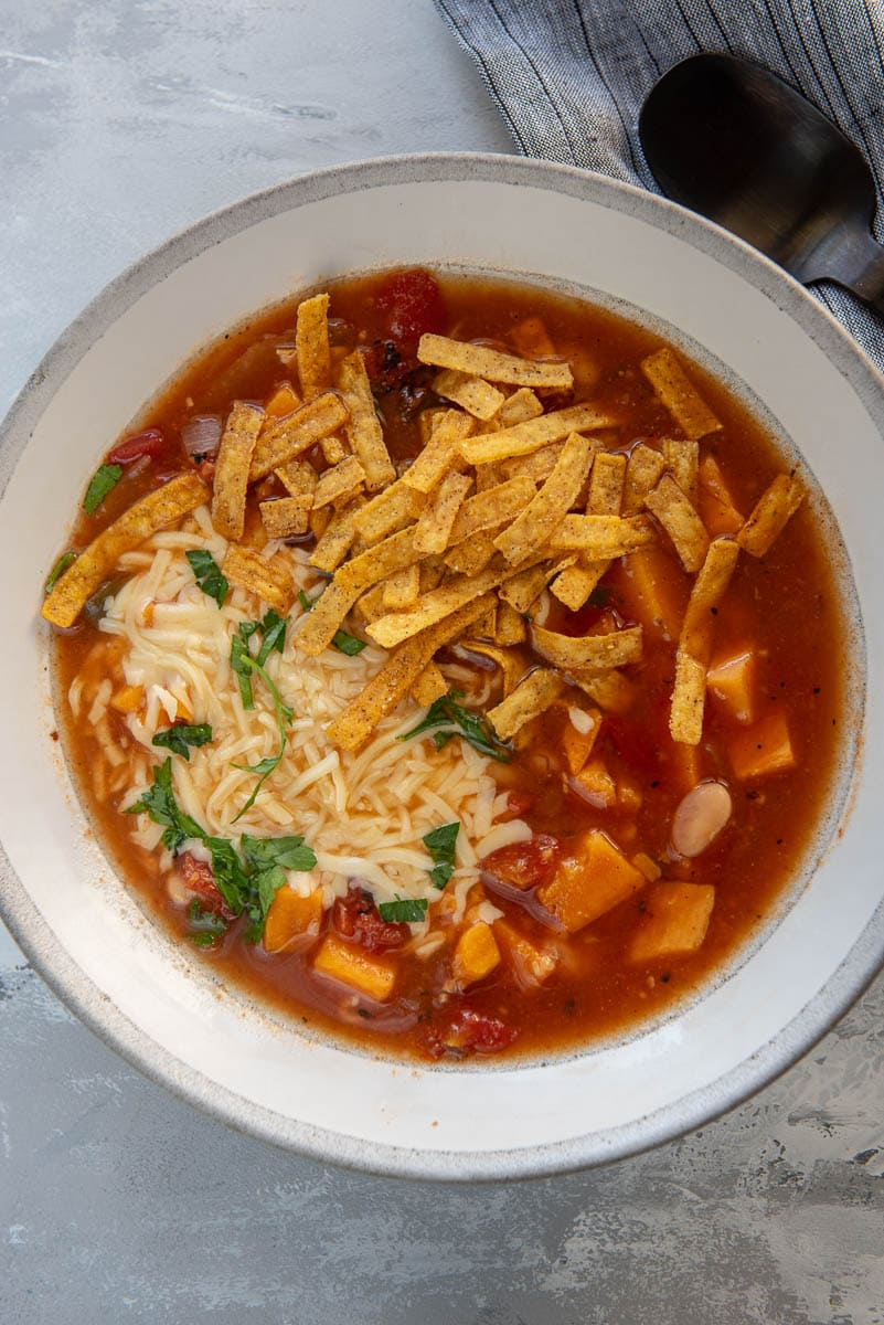 vegetarian soup in gray and white bowl