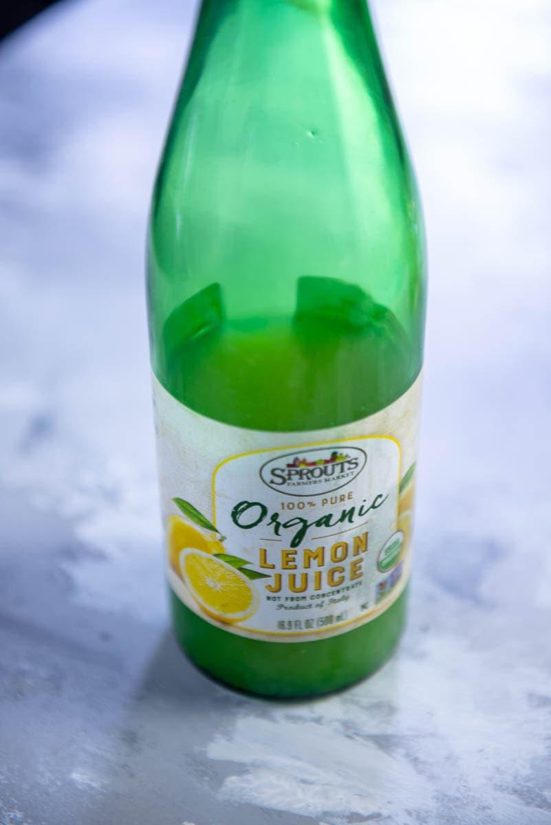 green bottle of organic lemon juice