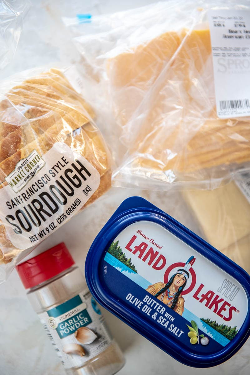 bread, cheese, garlic powder and butter to make grilled cheese sandwiches