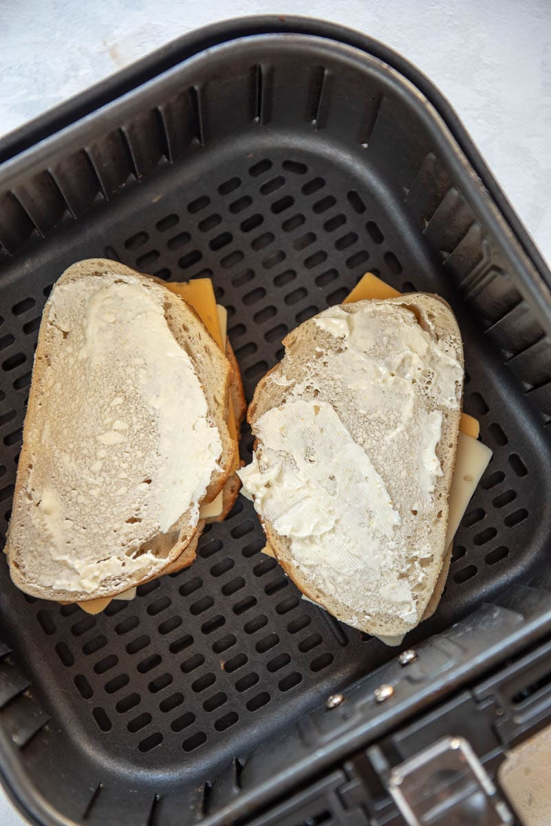 uncooked grilled cheese in air fryer basket