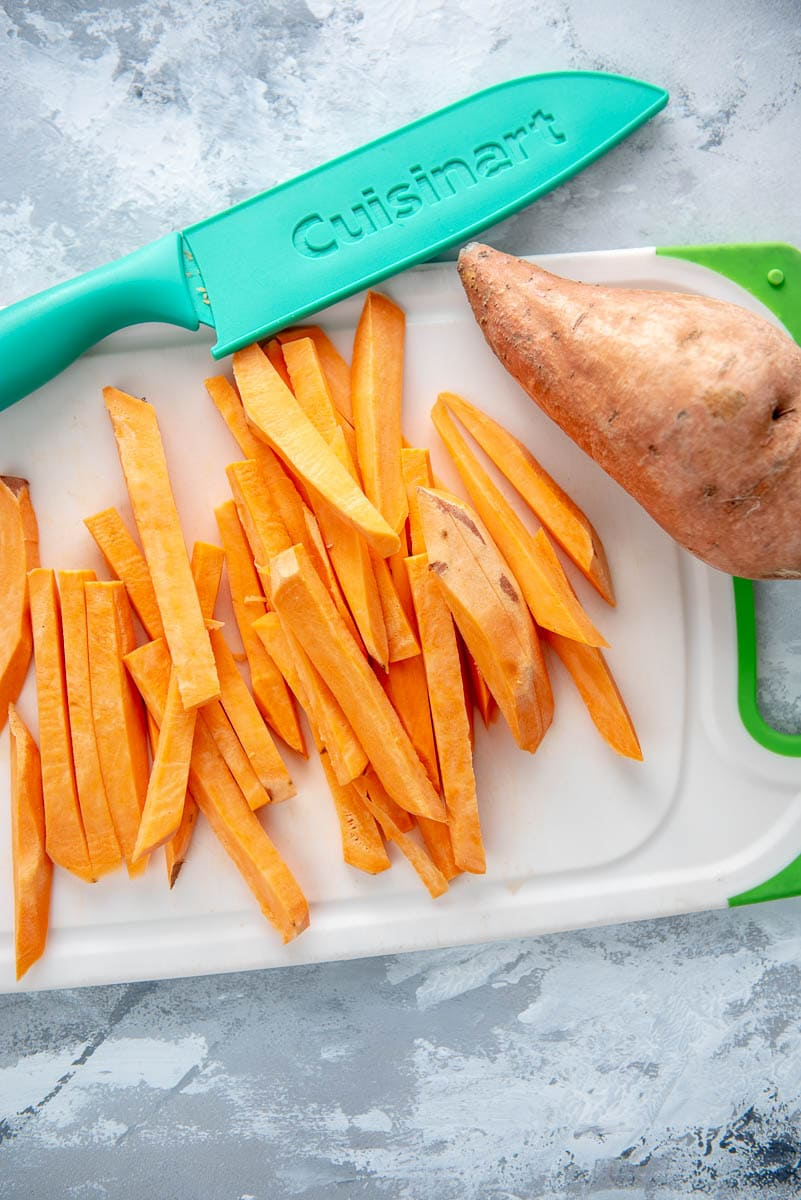 cutting board with sweet potatoes for fries