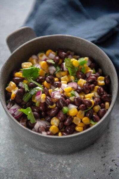 black bean and corn salsa in metal bowl