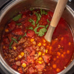 instant pot with taco soup and ladle
