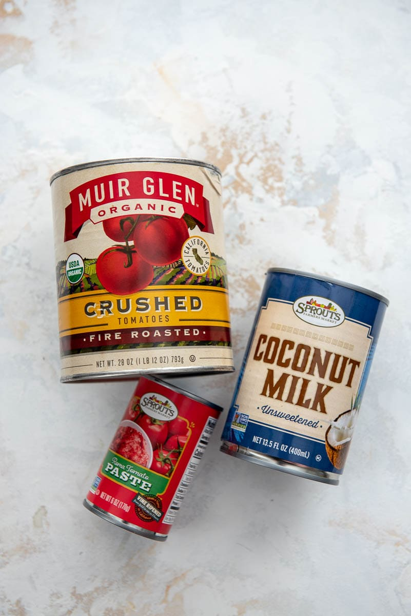 view of cans of crushed tomatoes, tomato paste and coconut milk