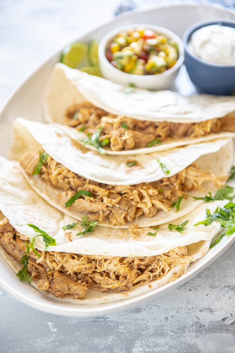 Instant Pot Chicken Tacos Garnished Plate