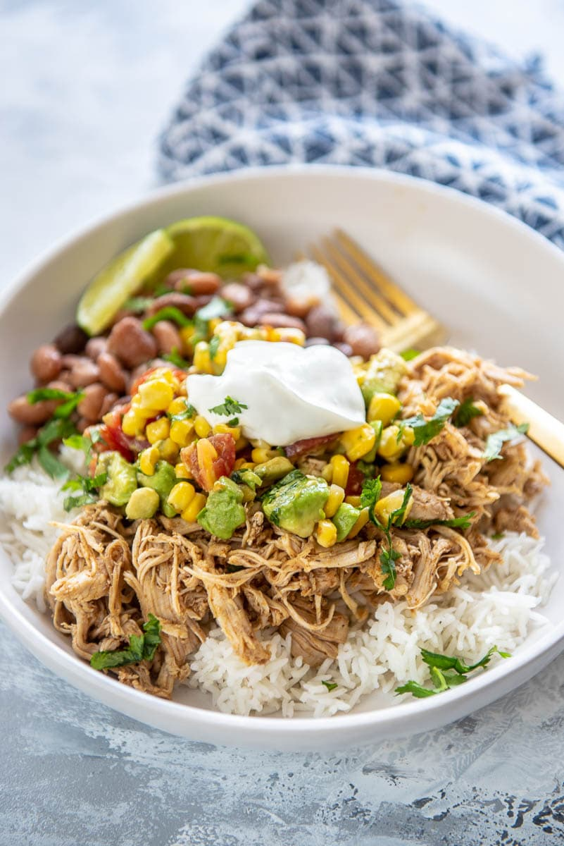 chicken burrito bowl with corn salsa over rice