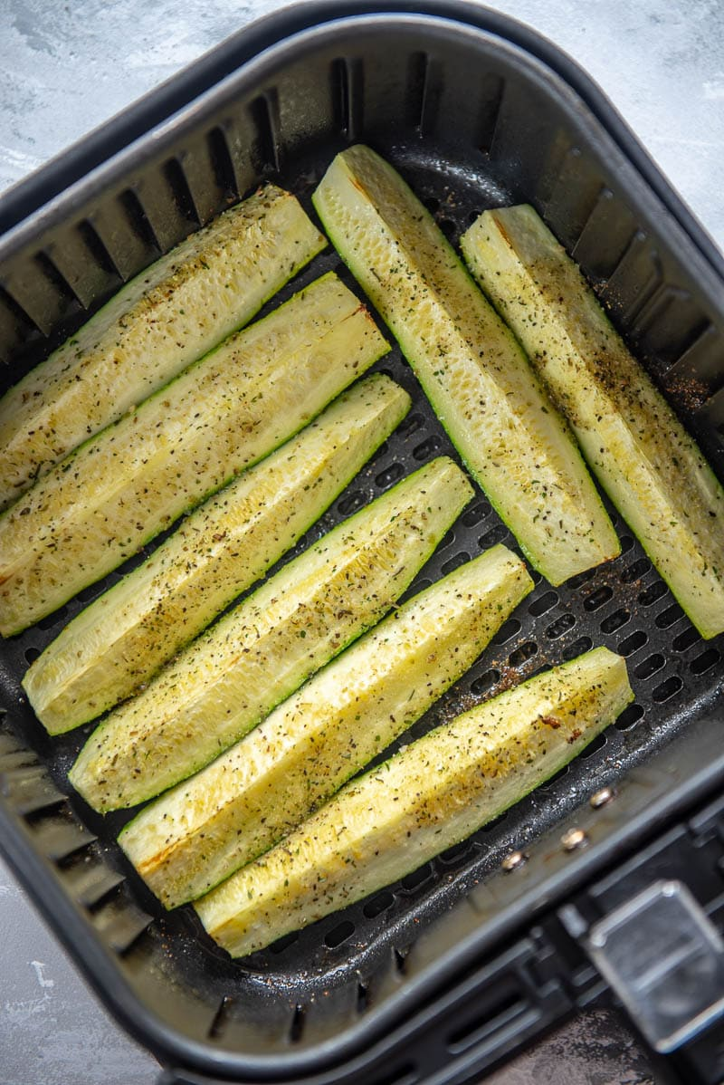 zucchini cooking in an air fryer