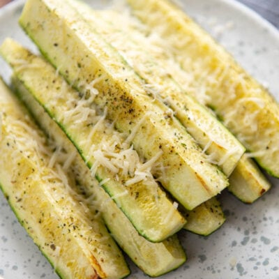 air fryer zucchini on a white plate