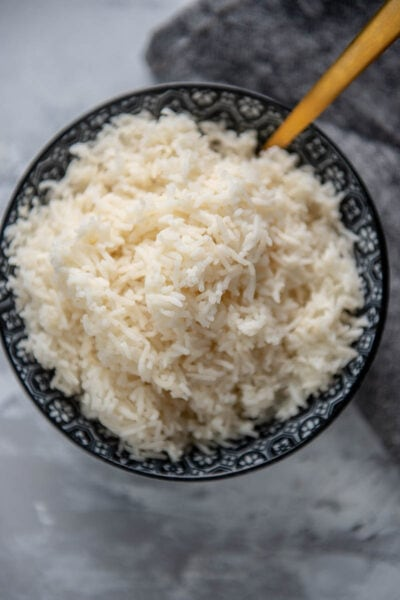 cooked basmati rice in a bowl with spoon