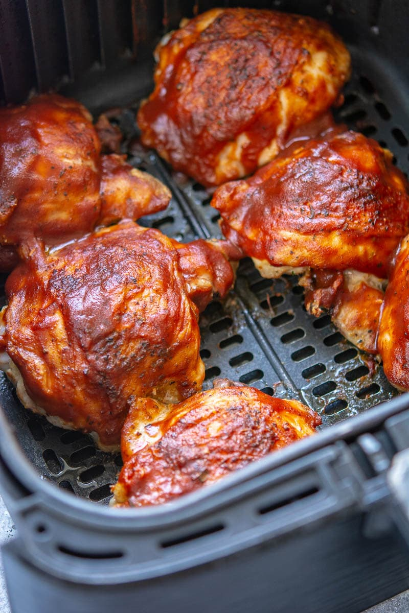 chicken with BBQ sauce in air fryer pan